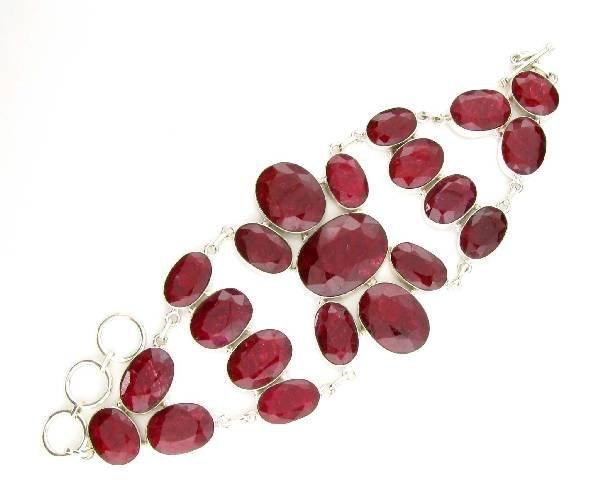 APP: 14k 164CT  Oval Cut Ruby & Sterl Silver Bracelet