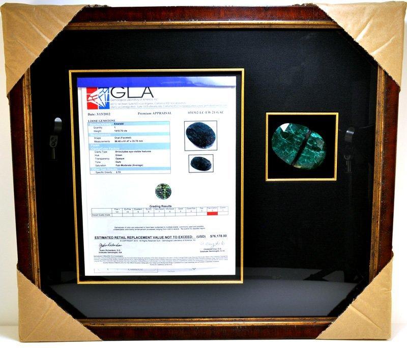 APP: 76k 1410CT Museum Framed Oval Cut Emerald Gemstone
