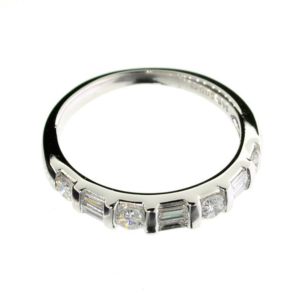 APP: 3k *14kt White Gold, & Baguette Diamond Ring