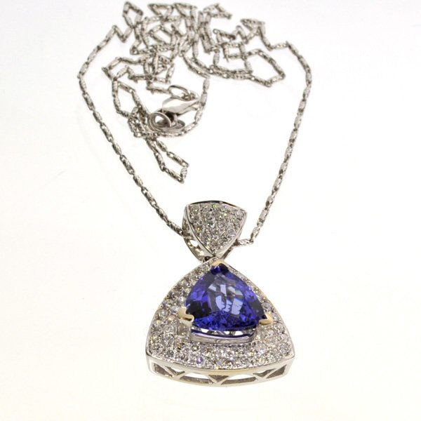 APP: 10k *14 kt White Gold Tanzanite & Diamond Pendant