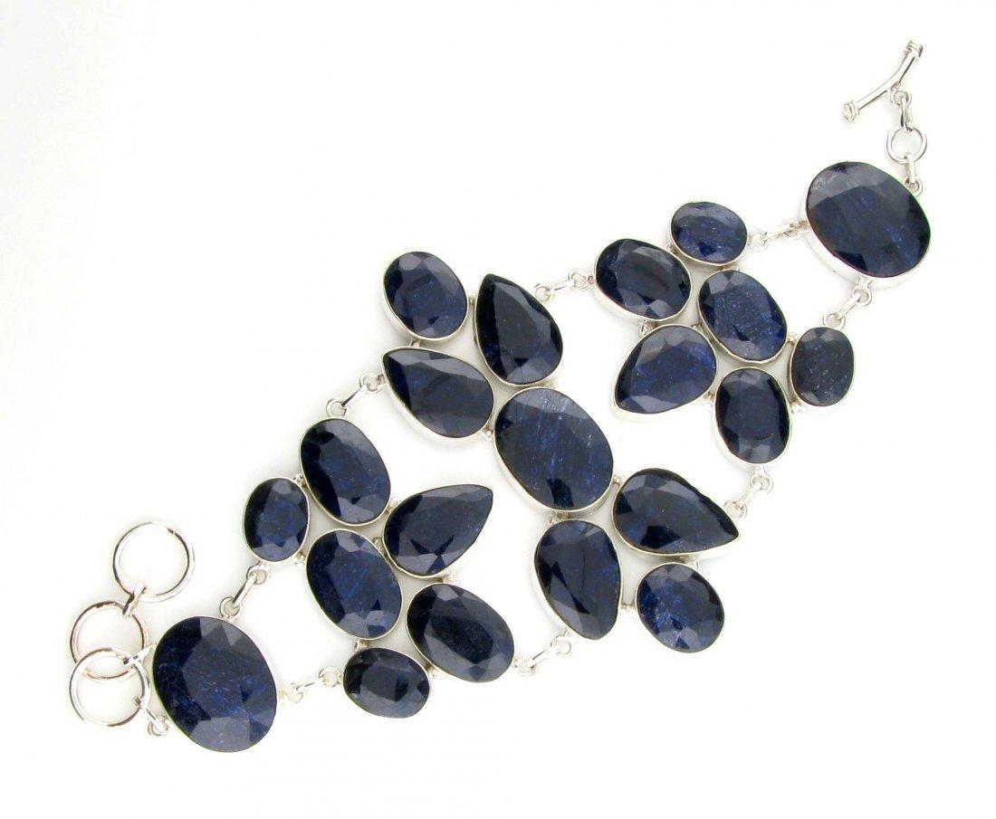 APP: 15k 201CT  Mixed Cut Sapphire & Silver Bracelet