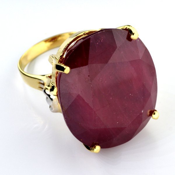APP: 30.8k 14 kt Gold 62.06CT Oval Cut Ruby Ring
