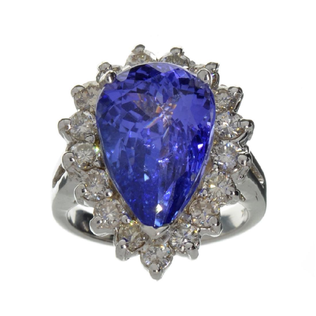 APP: 24.1k 14 kt. White Gold, 7.10CT Pear Cut Tanzanite