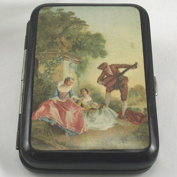 1002: Tin Cigarette Holder w/ Victorian Scene 85x55x13m