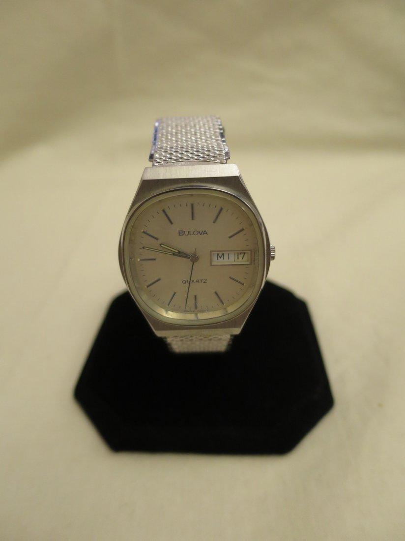 3 Wrist watch mechanisms and 2 wrist watches.