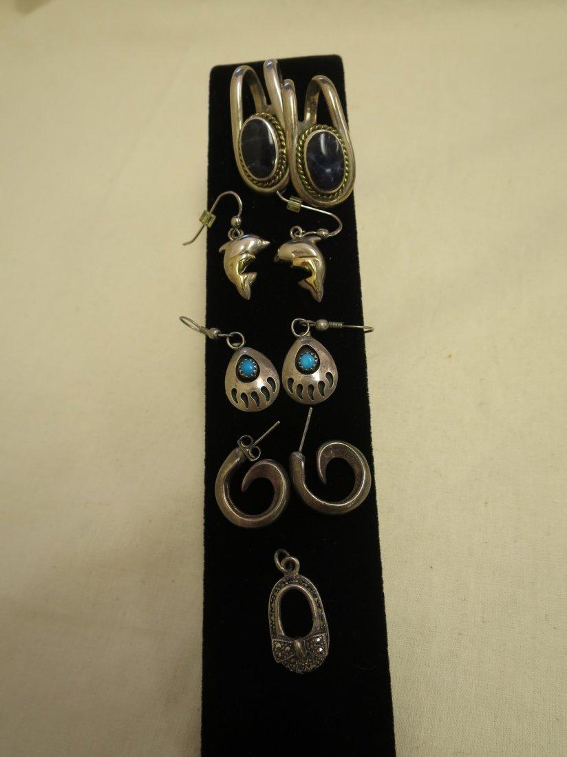 4 Pair Sterling earrings and 1 sterling pendant.