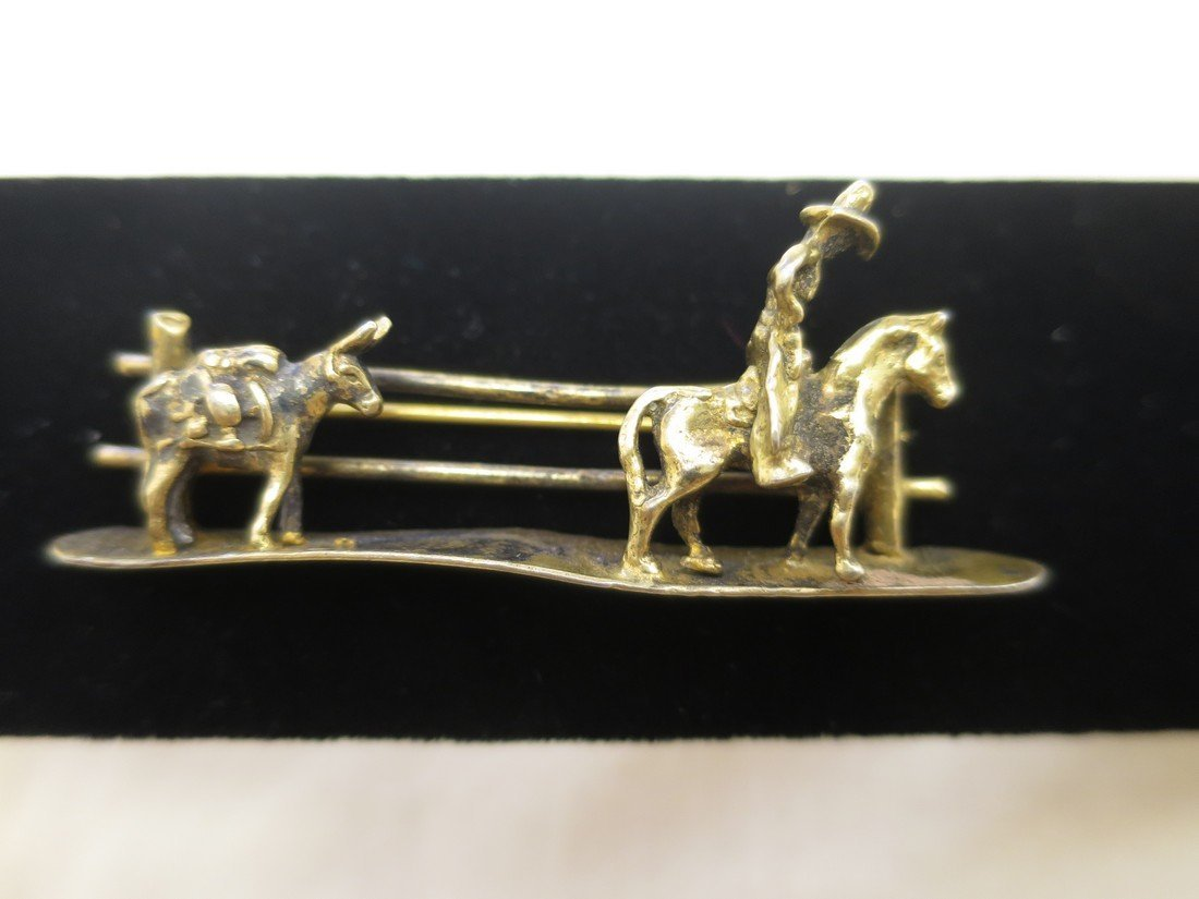 Sterling cowboy and donkey brooch.