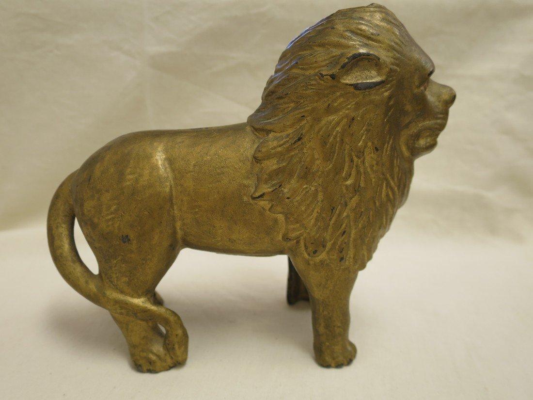 Brass lion coin jar.