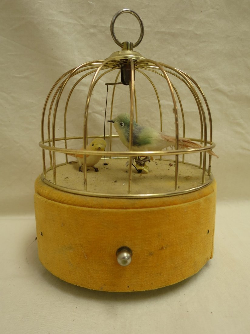 Vintage music box bird cage with drawer.