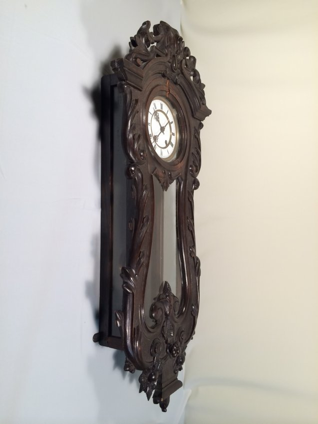 European hardwood carved wall clock.