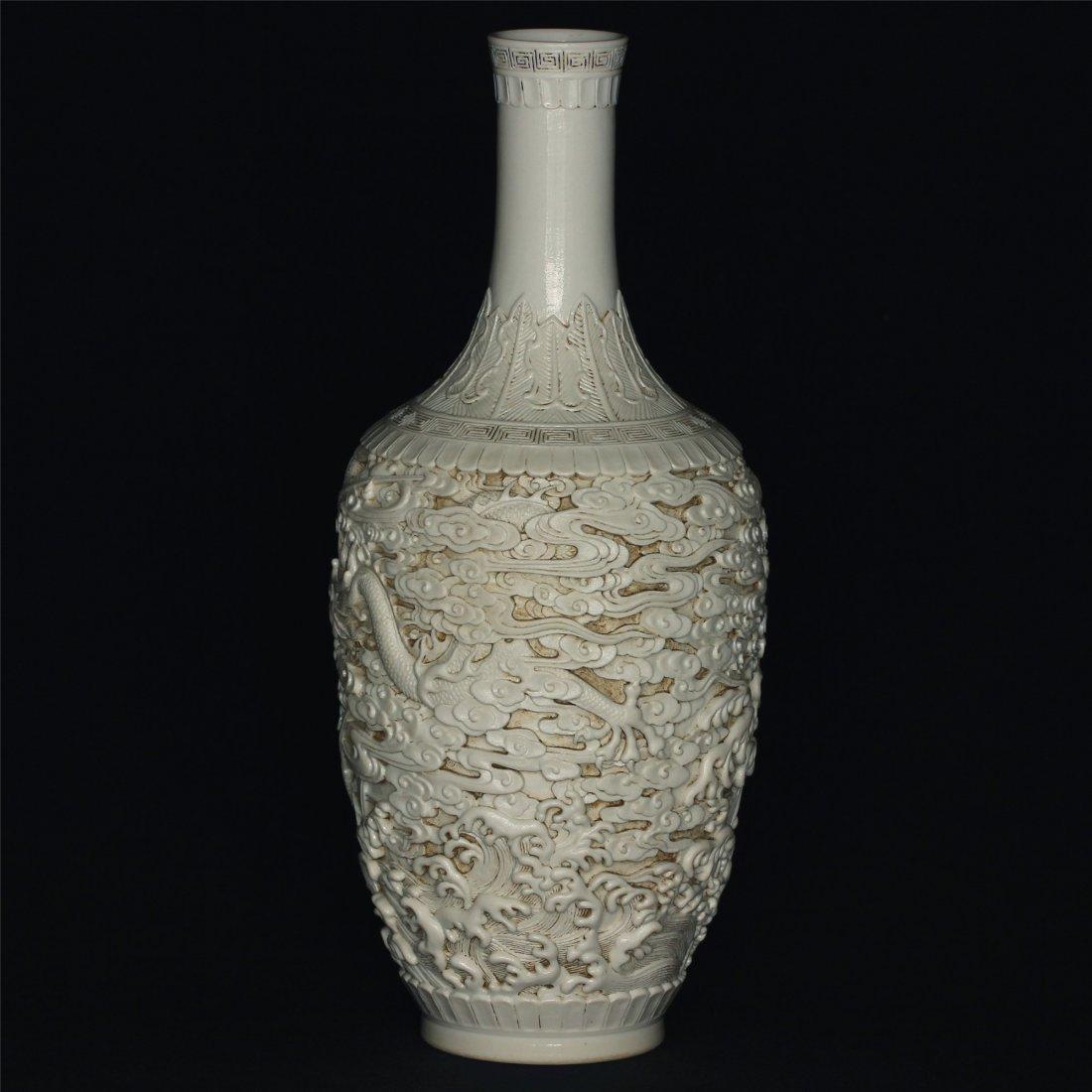 White glaze carving porcelain vase of Qing Dynasty