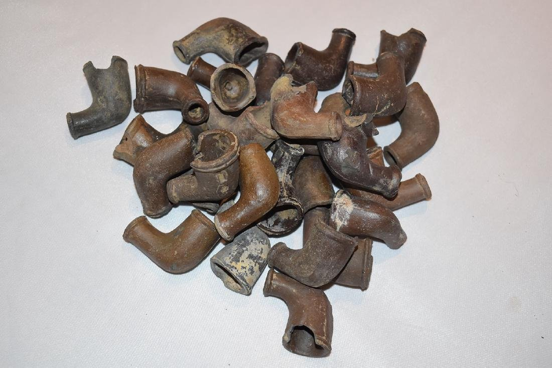 Lot of 27 early historic trade pipes, most have damage.