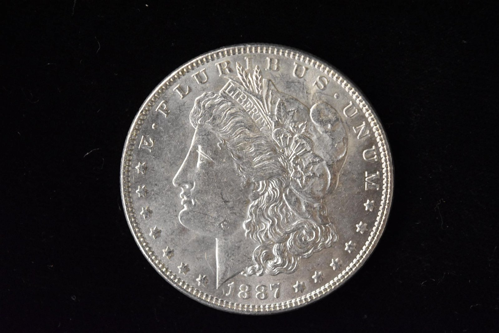 1887 High Grade Morgan Silver Dollar Grade By Picture.