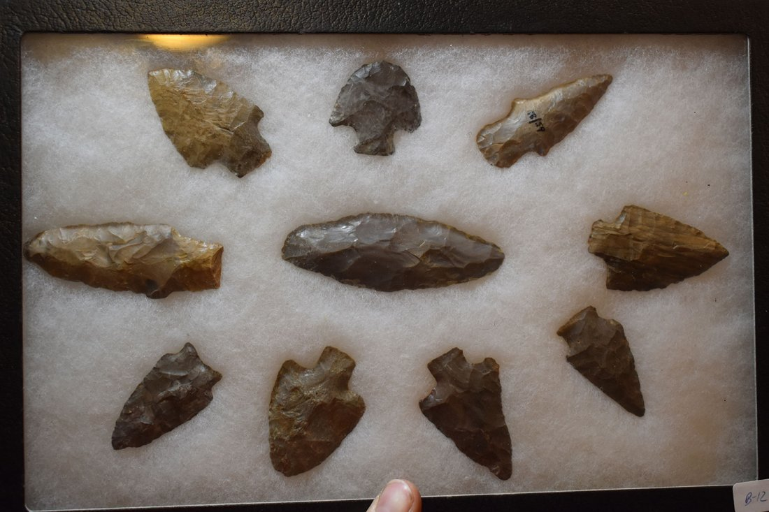 "8 1/2"" X 12"" FRAME OF 10 ARROWHEADS FROM LOGAN CO,"