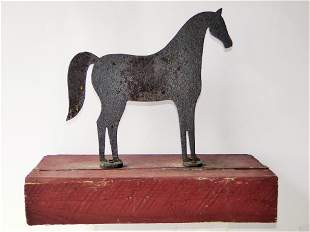 19TH C IRON HORSE WINDMILL WEIGHT, MOUNTED ON A STAND,