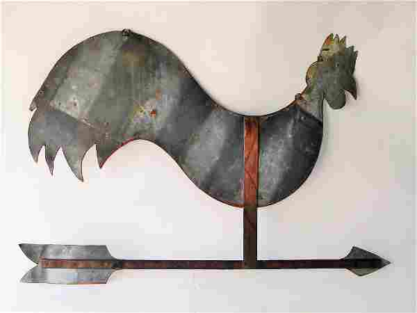 ANTIQUE SHEET METAL ROOSTER PERCHED ON AN ARROW