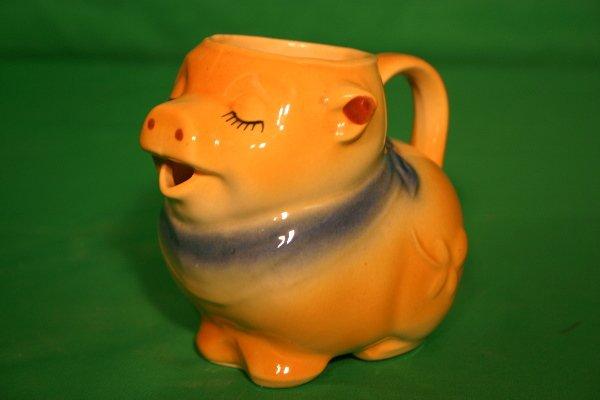 15: Shawnee yellow pig creamer