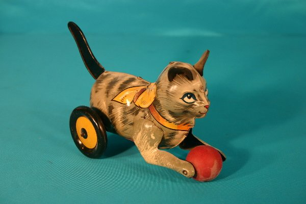 59: Marx lever action tin lithograph cat toy