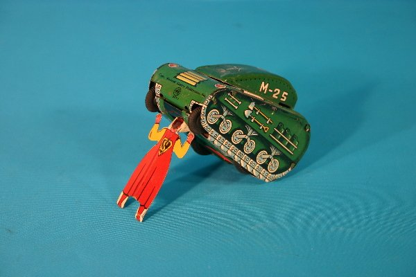 60: Line Mar tin lithograph Superman lifting tank key w