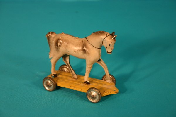 64: Metal horse pull toy