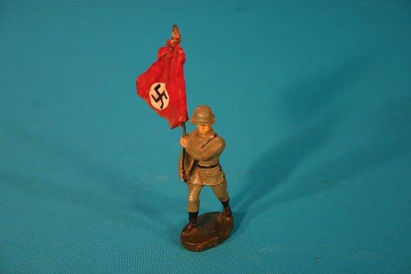 65: Circa 1940s German composition toy soldier