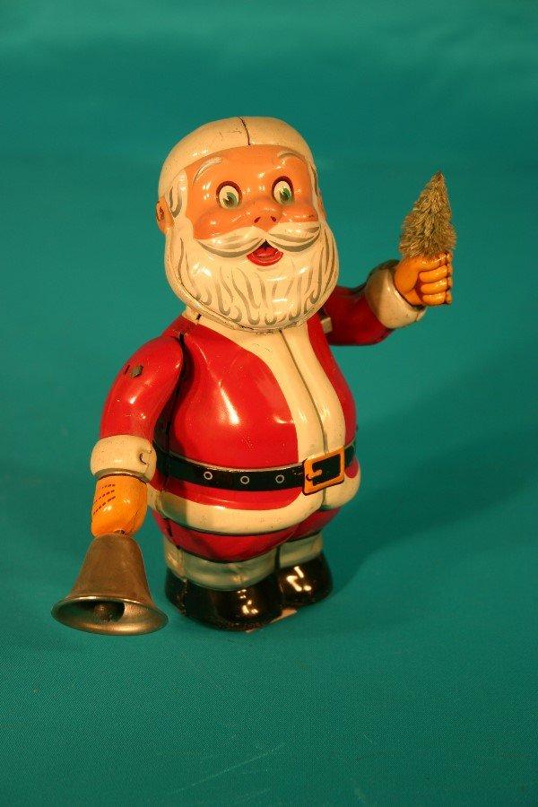 72: Tin lithograph key wind Santa bell ringer