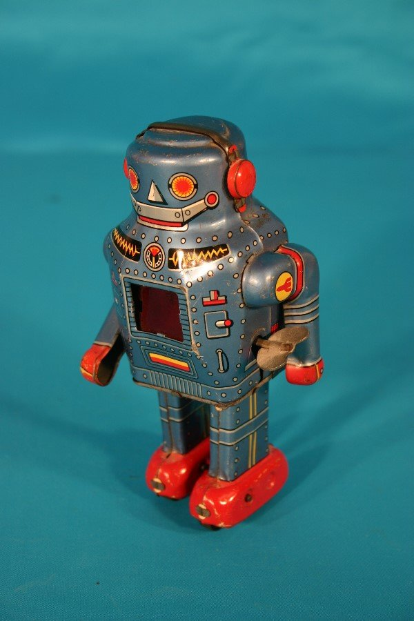 73: Tin lithograph key wind toy robot
