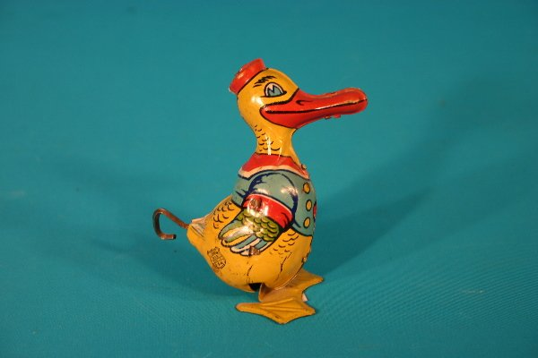 74: J. Chein tin lithograph key wind duck toy