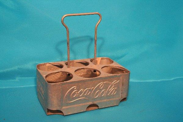 181: Coca-Cola embossed metal Six (6) pack carrier