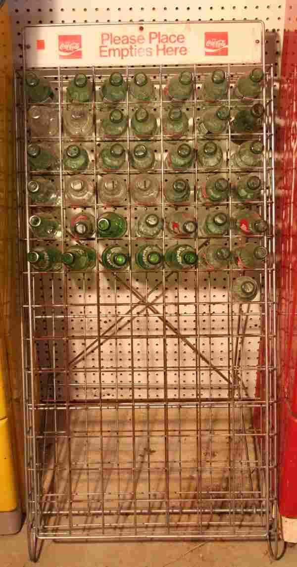 Coca-Cola empty bottle metal rack