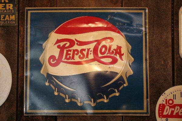 341: Pepsi-Cola bottle cap advertising sign
