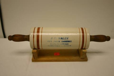 9: Pottery advertising rolling pin