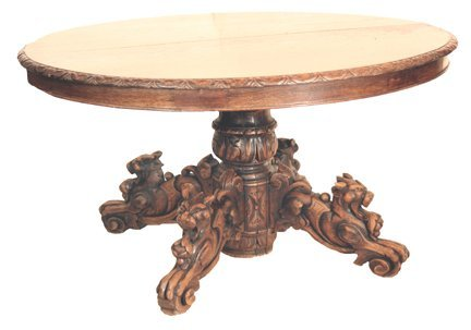 134: Oak dining table with 4 carved animal legs