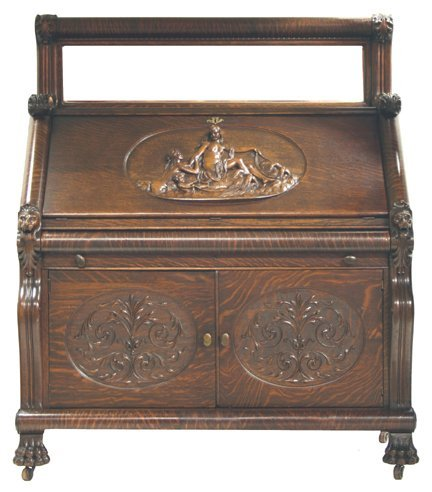206: Oak slant desk with carved sea nymphs and ladies o