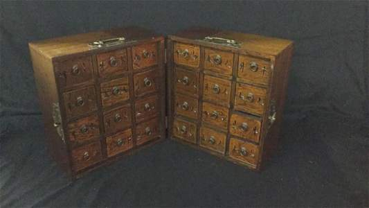 Table top Asian hinged apothecary cabinet