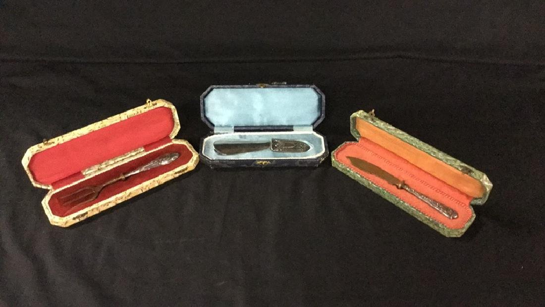 Metal knife fork and shoe horn in decorative boxes