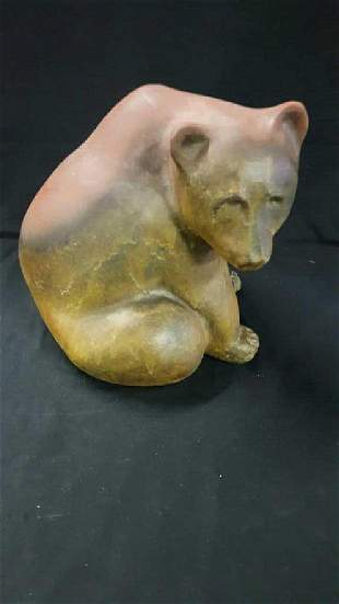 Signed plaster brown bear with signature