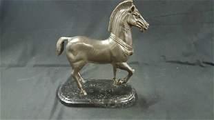 Bronze trojan horse sculpture on marble base