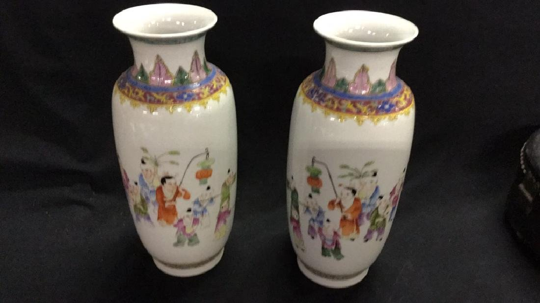 Pair of painted porcelain Chinese vases.