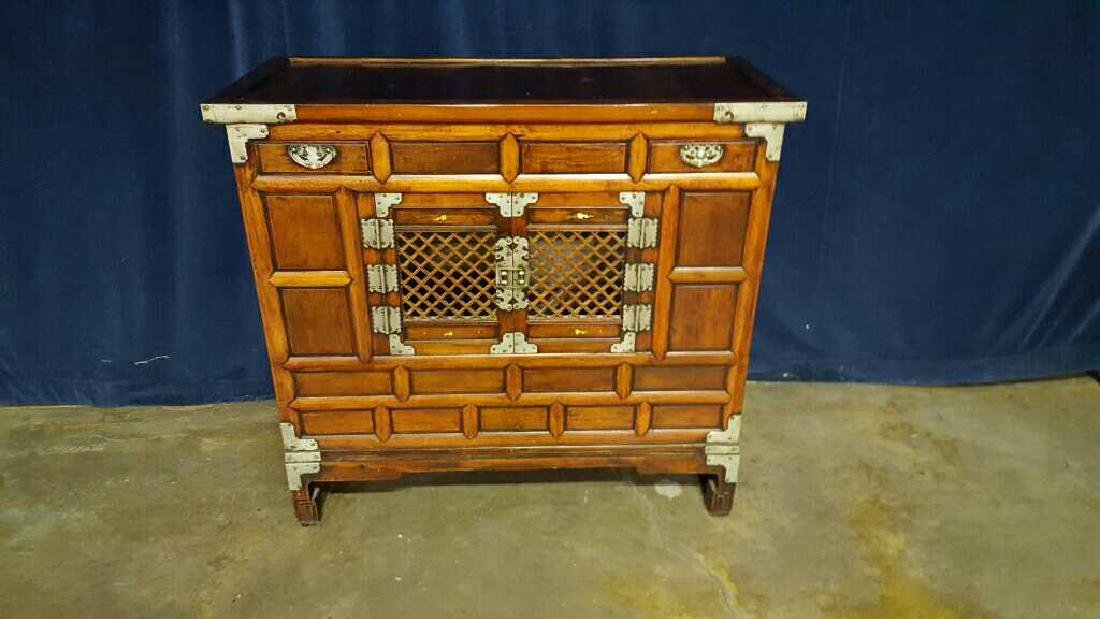 Two Asian style commodes