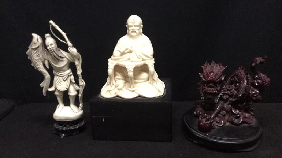 Three Asian figures