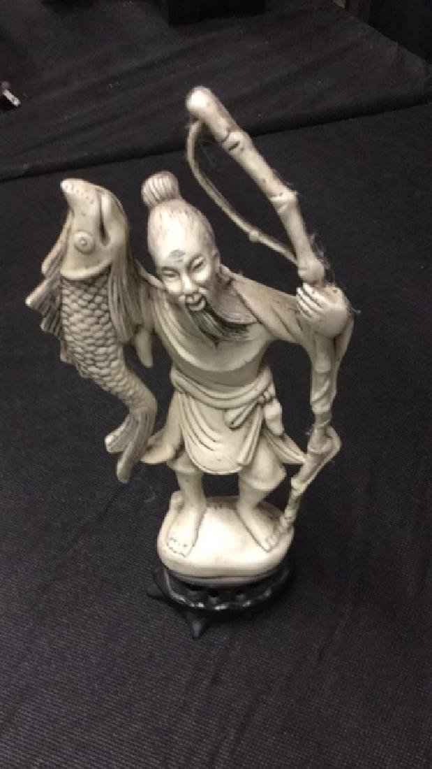 Three Asian figures - 2