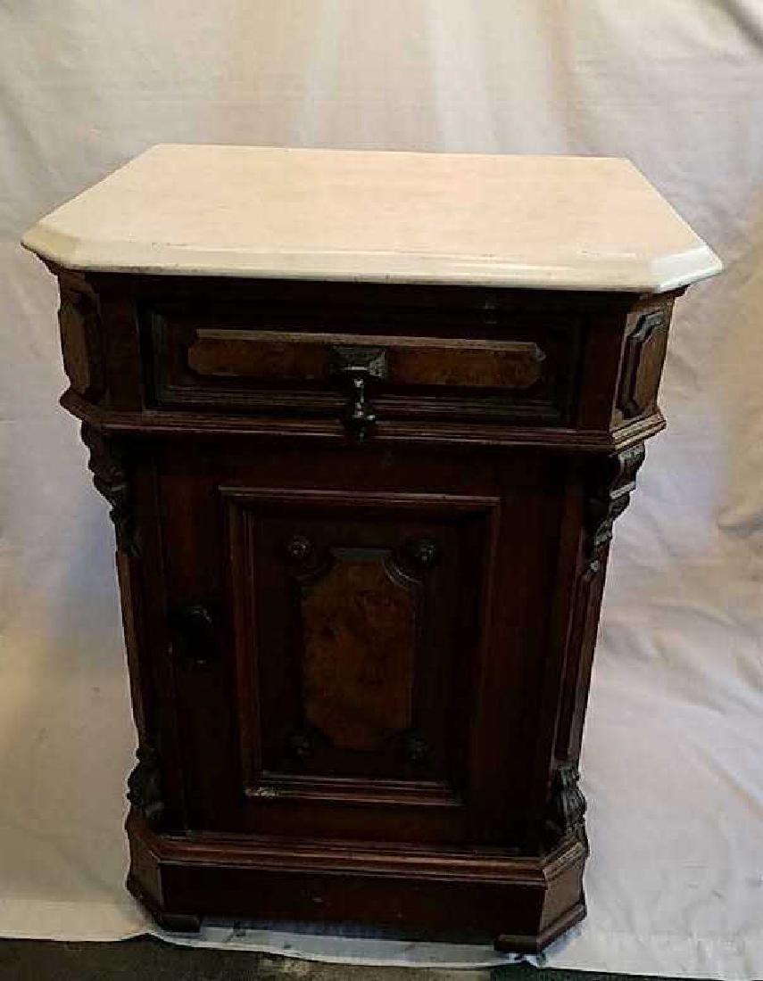 Marble top Eastlake walnut nightstand.
