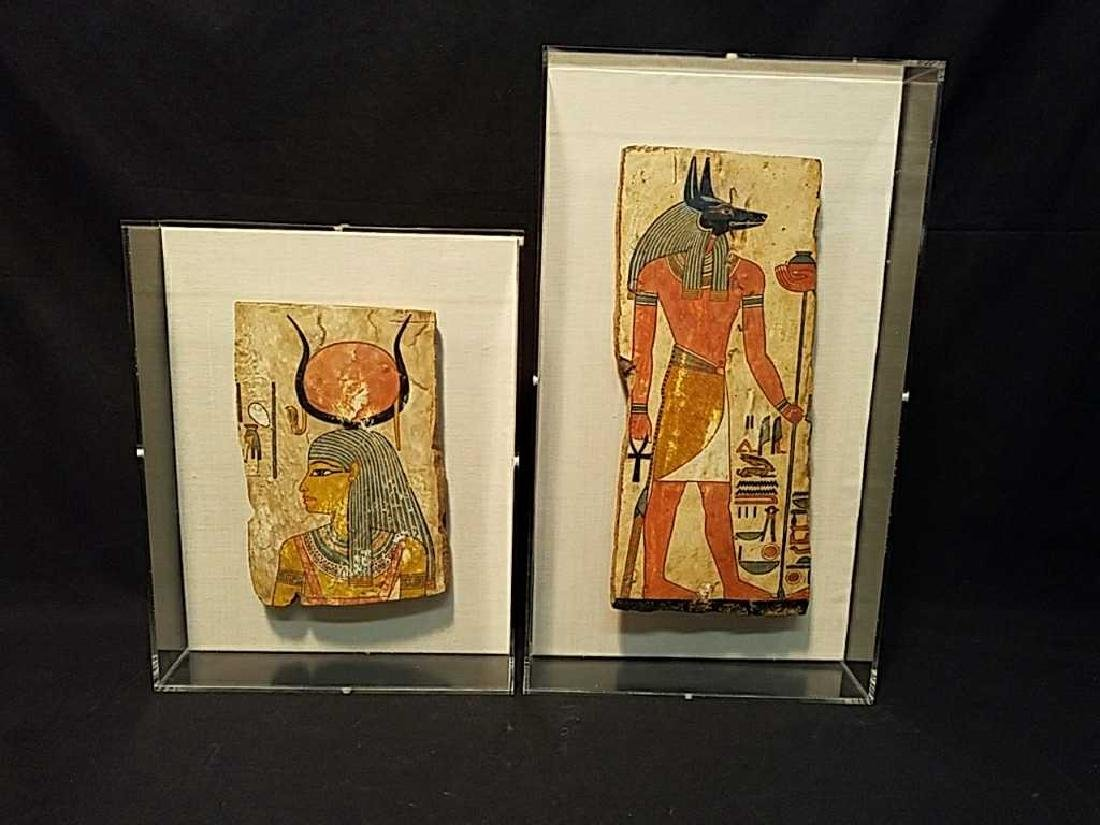 Egyptian tomb artifacts in acrylic frames