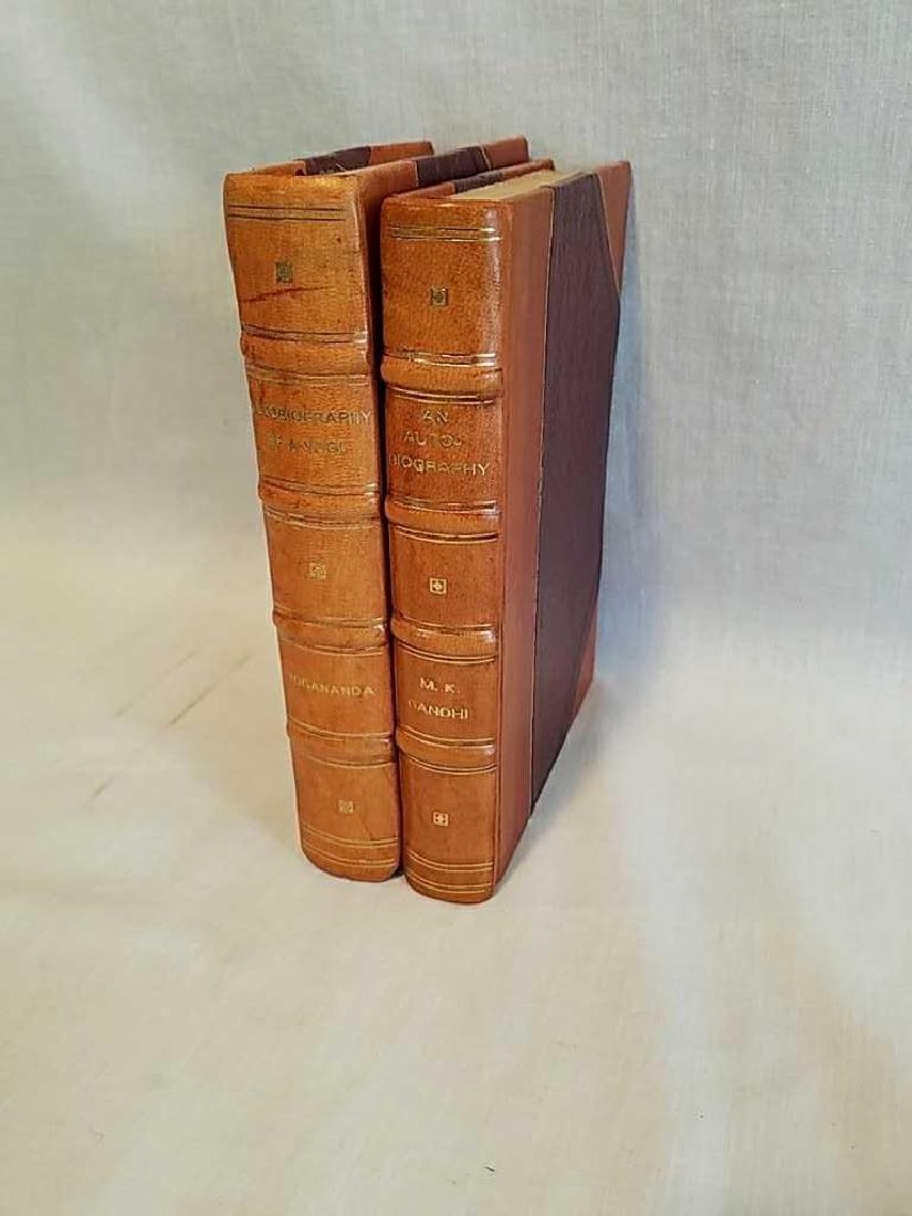 Two leather bound Autobiography Yogananda MK Gandhi