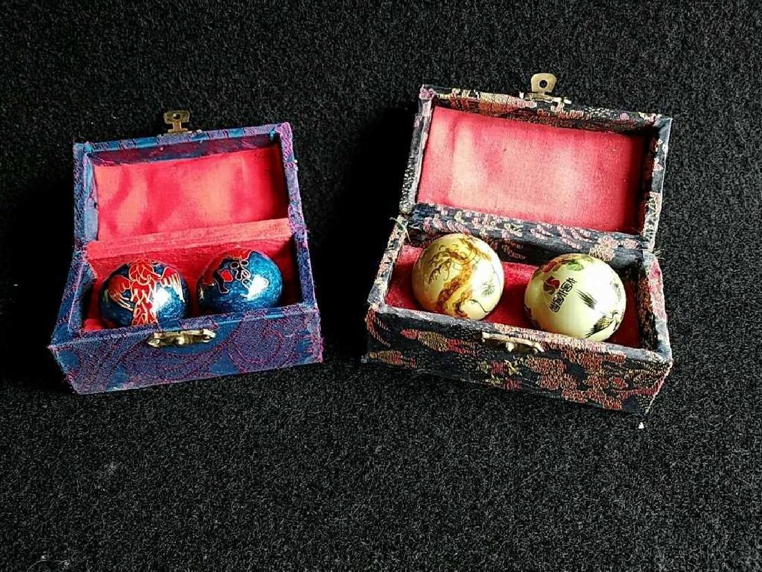 Two pairs Vintage yin yang balls