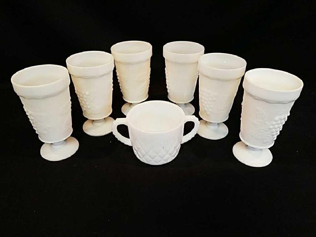 Six  white glass goblets and two handled cup