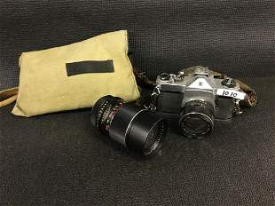 Vintage film camera and lens in case