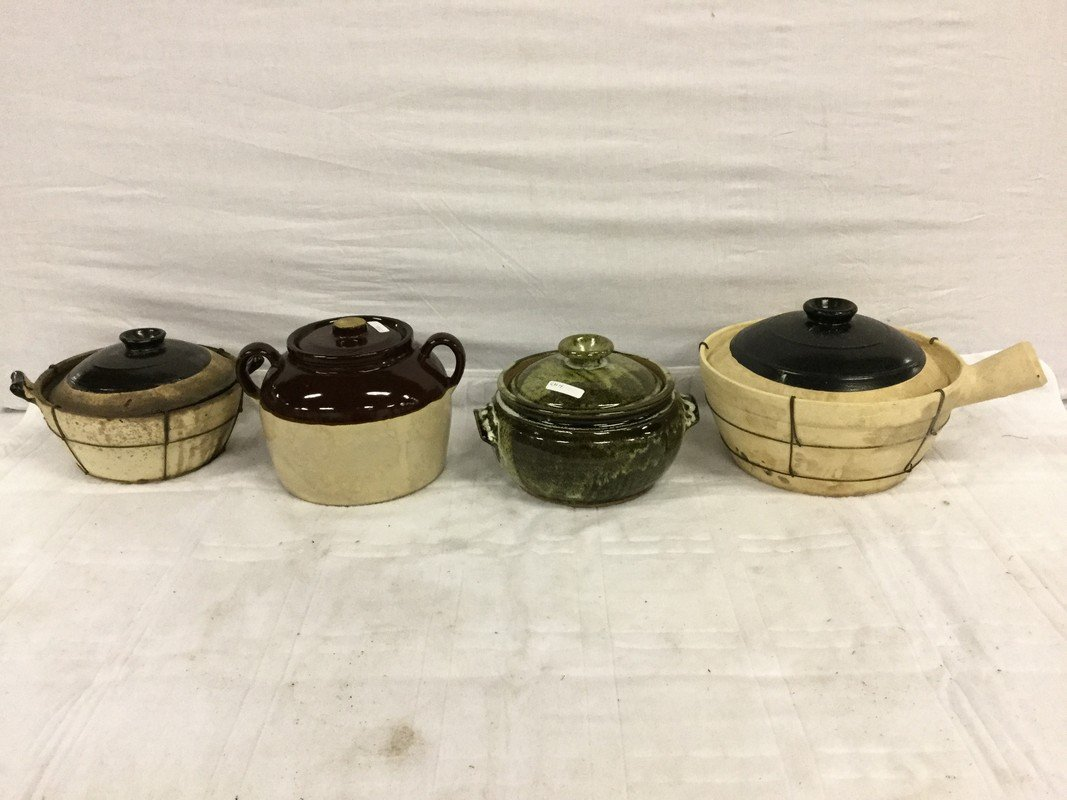 Four ceramic crocks