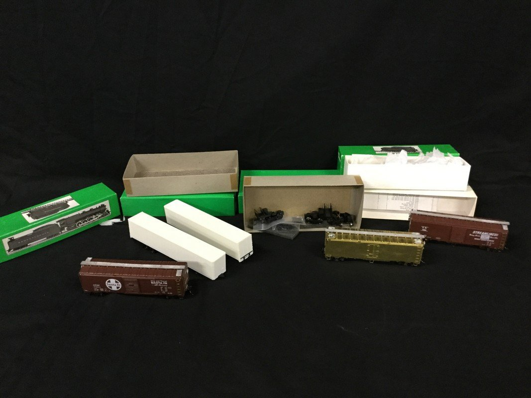 Three Bowser Freight cars and two Bowser 53' Smooth